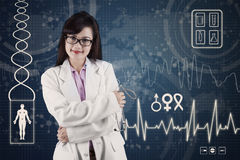 Female doctor with medical background Royalty Free Stock Photo