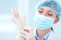 Female doctor in medical gloves Stock Photo