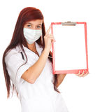Female doctor in medical mask holding clipboard Royalty Free Stock Photos