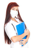 Female doctor in medical mask holding notepad Royalty Free Stock Photos