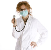 Female doctor in medical mask keeping stethoscope Royalty Free Stock Photos