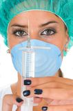 Female doctor medical operation dress and syringe Royalty Free Stock Image