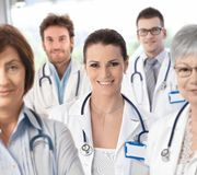 Female doctor with medical team Royalty Free Stock Photography