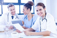 Female doctor meeting with colleagues Royalty Free Stock Photos