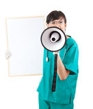Female doctor with megaphone and blank sign Stock Photo
