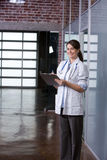 Female Doctor in a modern office Royalty Free Stock Photography