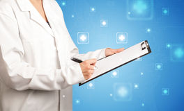 Female doctor with notepad Royalty Free Stock Photography