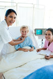 Female Doctor and nurse examining a patient Stock Photos