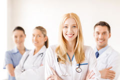 Female doctor or nurse in front of medical group Royalty Free Stock Image