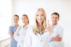 Female doctor or nurse in front of medical group Royalty Free Stock Photography