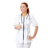 Female doctor or nurse gesturing ok Stock Photos