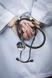 Female Doctor or Nurse In Handcuffs Holding Stethoscope Royalty Free Stock Images