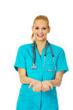 Female doctor or nurse holding something on open palms Royalty Free Stock Photos