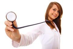 Female doctor or nurse holding stethoscope. stock photos