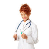 Female doctor or nurse holding syringe Stock Photo