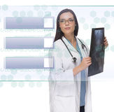 Female Doctor or Nurse Holding X-Ray Reading Blank Button Panel Stock Images