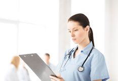Female doctor or nurse in hospital Stock Images