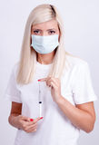 Female doctor or nurse in medical mask holding syringe with inje Stock Photos