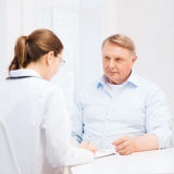 Female doctor or nurse with old man prescrbing Stock Images