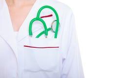 Female doctor or nurse with stethoscope inside lab coat pocket stock images