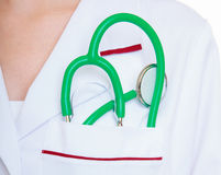 Female doctor or nurse with stethoscope inside lab coat pocket Royalty Free Stock Images