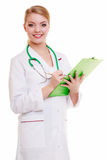 Female doctor or nurse with stethoscope writing with pen on clipboard. Royalty Free Stock Image
