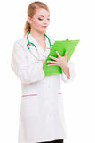 Female doctor or nurse with stethoscope writing with pen on clipboard. Royalty Free Stock Images