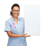 Female doctor or nurse with white blank board Royalty Free Stock Photos