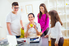 Female doctor nutritionist and patient teenagers.Doctor holding an apple Stock Images