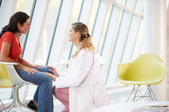 Female Doctor Offering Counselling To Depressed Woman Royalty Free Stock Image