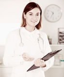 Female doctor offering help Stock Photo