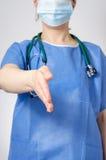 Female doctor offering her handshake Stock Images