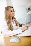Female doctor at the office Royalty Free Stock Image