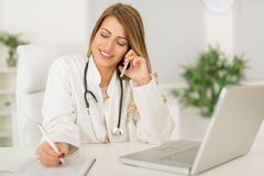 Female Doctor In The Office Royalty Free Stock Photos
