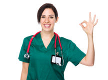 Female doctor with ok sign Royalty Free Stock Image
