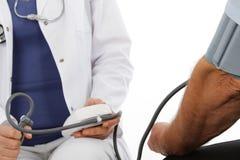 Female doctor and older man. Pressure gauge Royalty Free Stock Image
