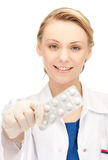 Female doctor with one pack of pills Stock Photography