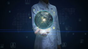 Female doctor open palm, Rotating earth, expanding social network service, media on palms.