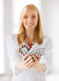 Female doctor with packs of pills Royalty Free Stock Photography