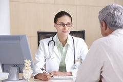 Female doctor and patient Stock Images