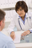 Female doctor and patient Stock Photos