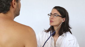 Female doctor with patient in the clinic stock footage