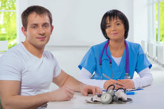Female doctor and patient looking at camera    selective focus o Stock Image