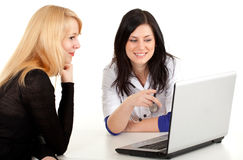 Female doctor with patient looking at laptop Stock Photography