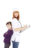 Female doctor pediatrician and girl standing Royalty Free Stock Photo