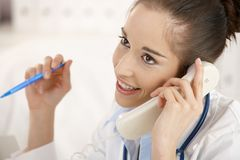 Female doctor on the phone Stock Photos