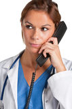 Female Doctor on the Phone Stock Images