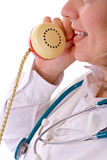 Female doctor on the phone - closeup. Smiling confident female doctor talking on the phone - isolated, closeup Stock Images
