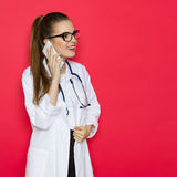 Female Doctor On The Phone Royalty Free Stock Photo