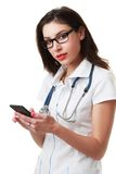 Female doctor with phone Stock Photos